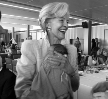 Dame Quentin Bryce gives Martine Harte's son a cuddle on www.engagingwomen.com.au